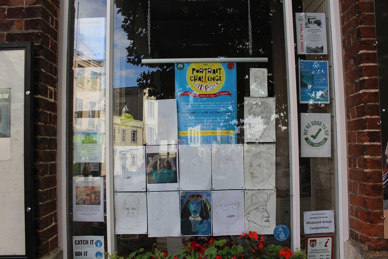 The Portrait Challenge In Bridport Tourist Information Centre Window